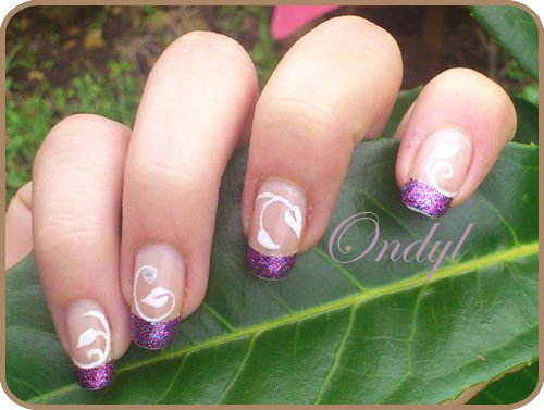 multicolored-glittered-french-manicure-and-little-white-lea.jpg