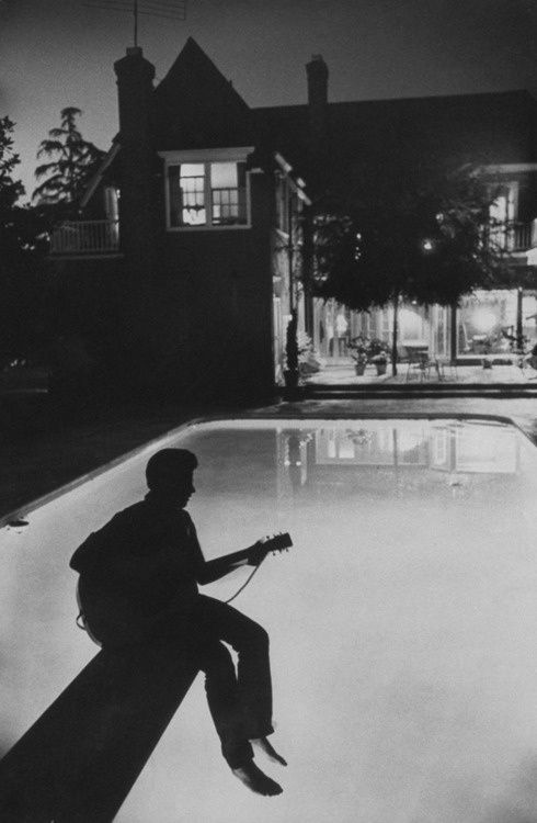 17-year-old-Ricky-Nelson-plays-guitar-in-the-backyard-of-hi.jpg