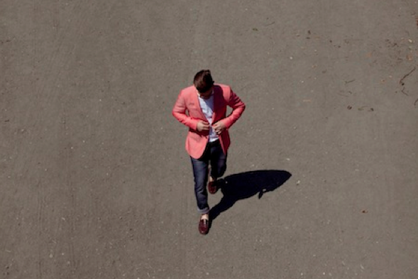 man-in red jacket on street